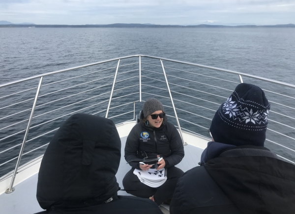 Marine Naturalist Educating Passengers