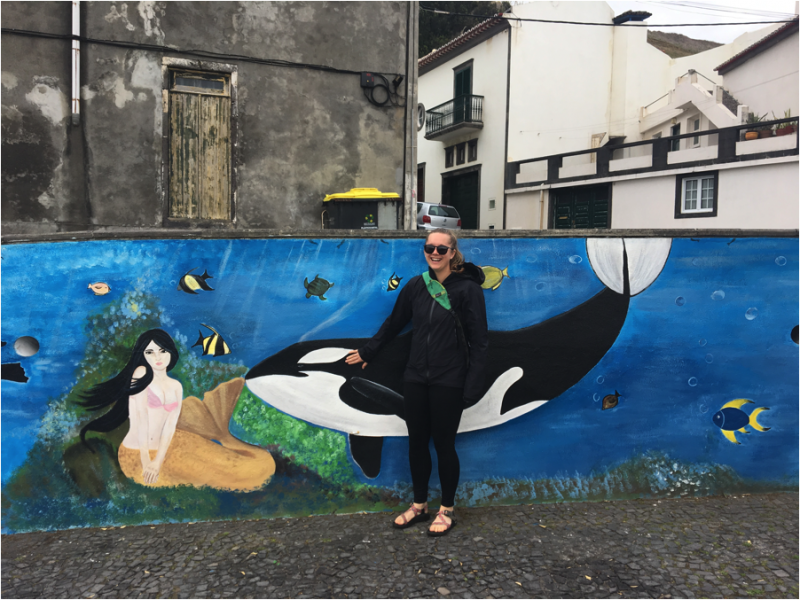Sarah with an orca mural in the Azores